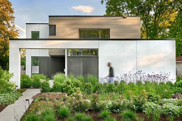 Example of a mid-sized minimalist black two-story concrete fiberboard exterior home design in Chicago