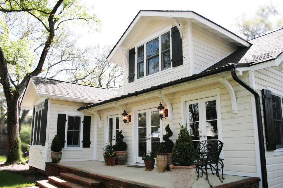 Example of a white exterior home design in Other