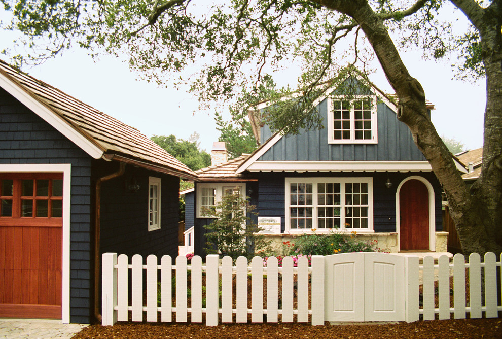 Example of a classic two-story wood exterior home design in Other
