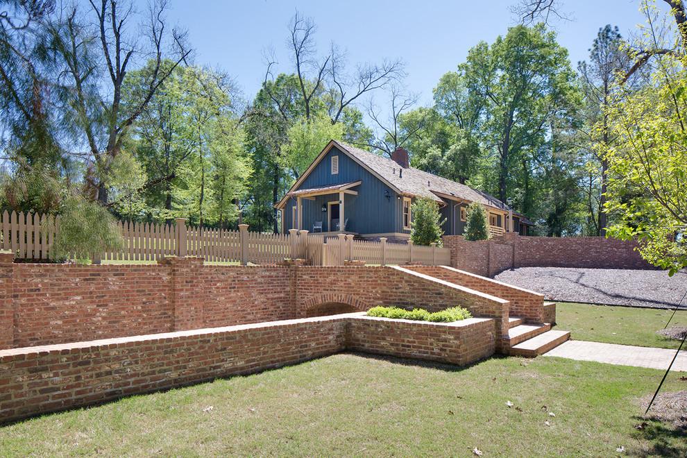 Example of a farmhouse exterior home design in Nashville