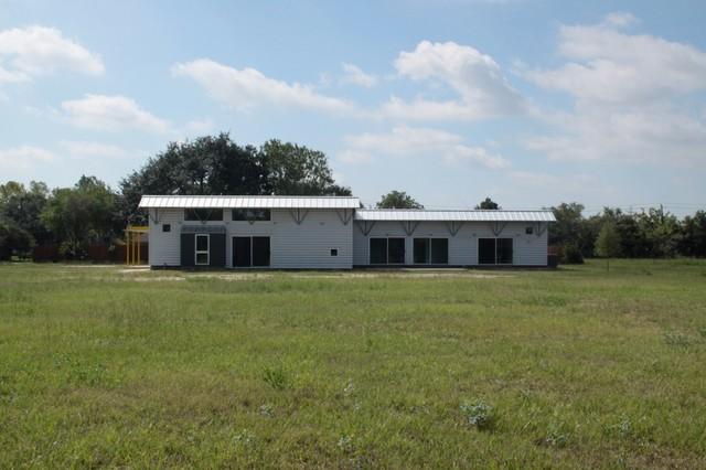 Gulf coast farmhouse for Industrial farmhouse exterior