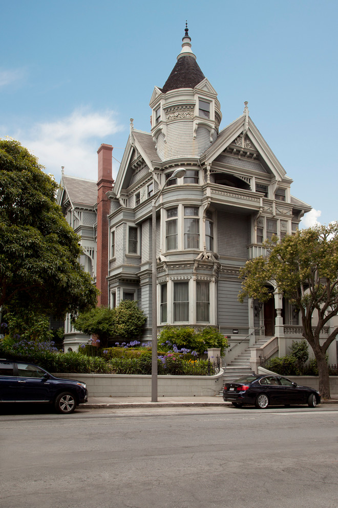 Example of an ornate gray three-story exterior home design in San Francisco