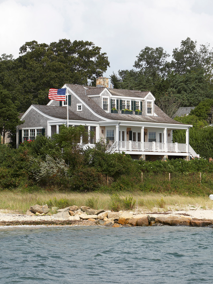 Inspiration for a mid-sized coastal gray two-story wood gable roof remodel in Boston