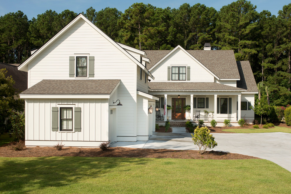 Inspiration for a farmhouse white two-story exterior home remodel in Charleston
