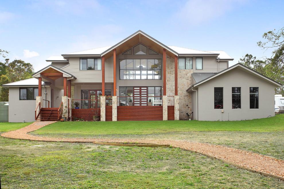 Trendy stone exterior home photo in Gold Coast - Tweed