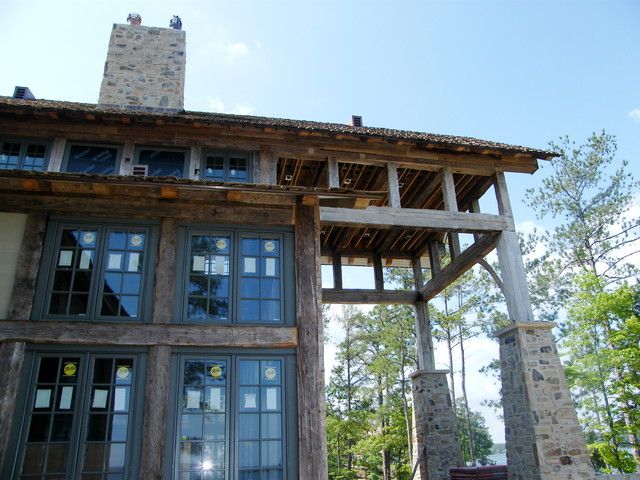Hand Hewn Timber Frame Lake Home traditional-exterior