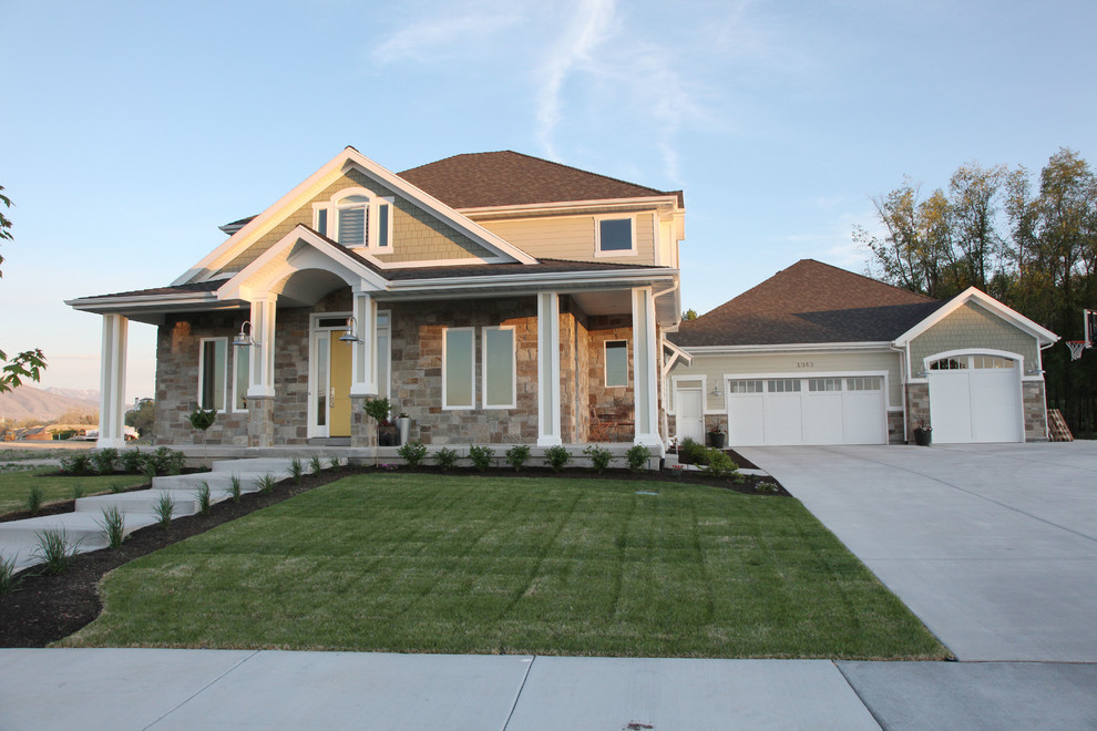 Example of a mid-sized arts and crafts green three-story mixed siding exterior home design in Salt Lake City