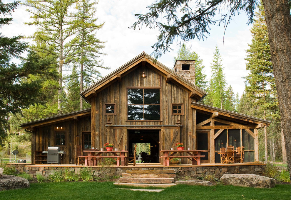 Example of a mid-sized mountain style wood exterior home design in Denver