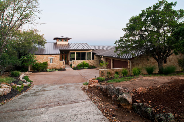 Hill Country Modern Parade Home Exterior And Driveway