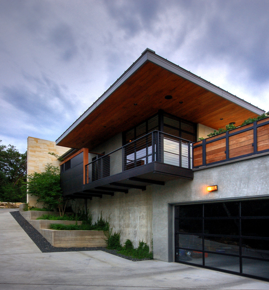 Inspiration for a modern concrete exterior home remodel in Austin