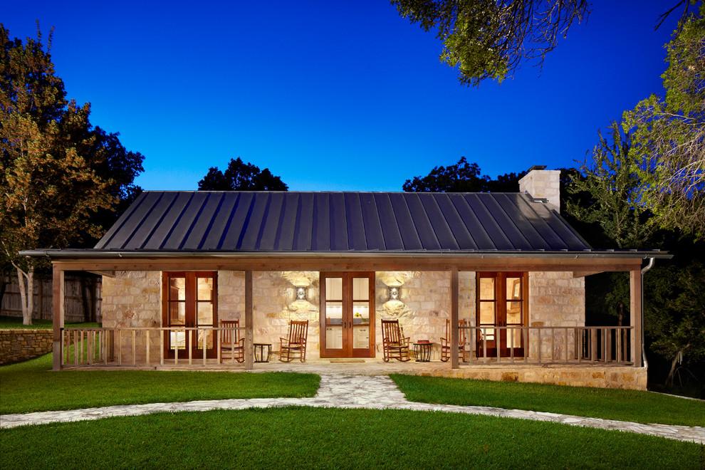 Farmhouse stone exterior home idea in Houston