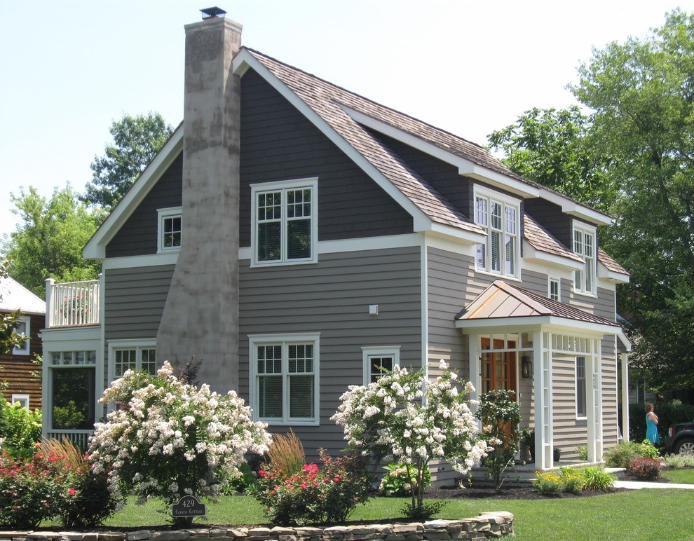 Mid-sized traditional gray two-story wood exterior home idea in Wilmington with a shingle roof