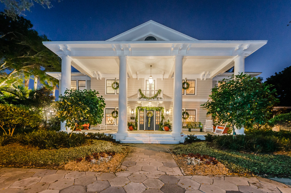 Example of a classic beige two-story wood exterior home design in Tampa
