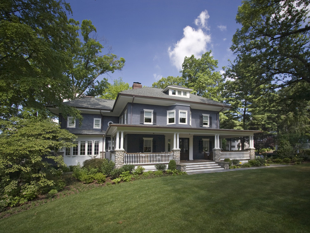 Large elegant blue three-story wood exterior home photo in New York with a hip roof