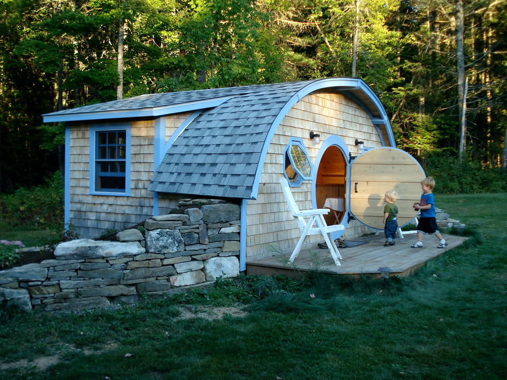 Small eclectic wood tiny house photo in Portland Maine