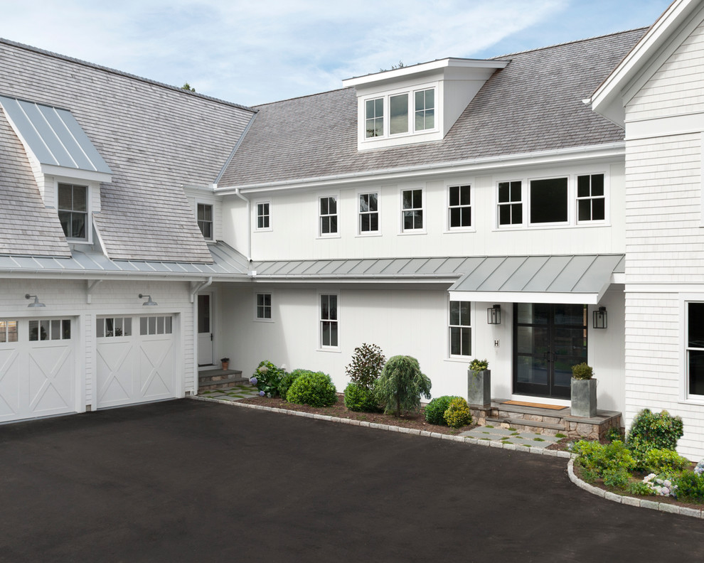 Large cottage white two-story wood gable roof photo in New York with a mixed material roof