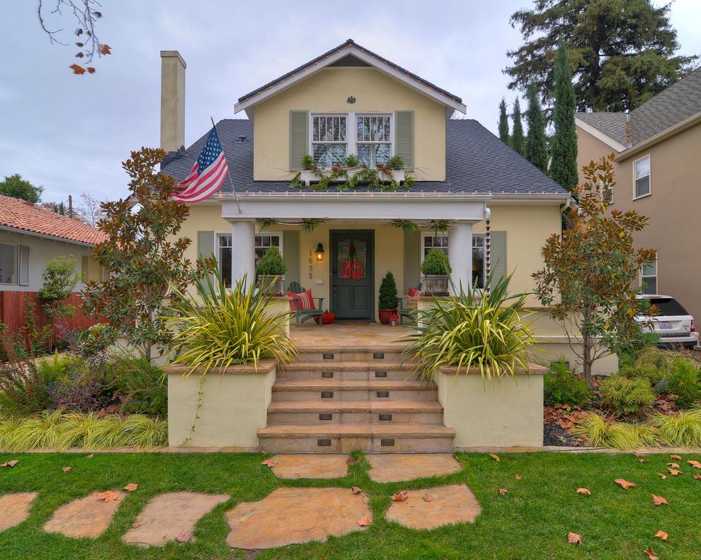 Elegant yellow exterior home photo in Sacramento