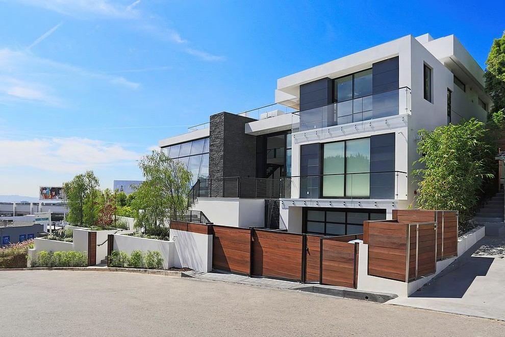 Inspiration for a huge contemporary white three-story concrete exterior home remodel in Los Angeles