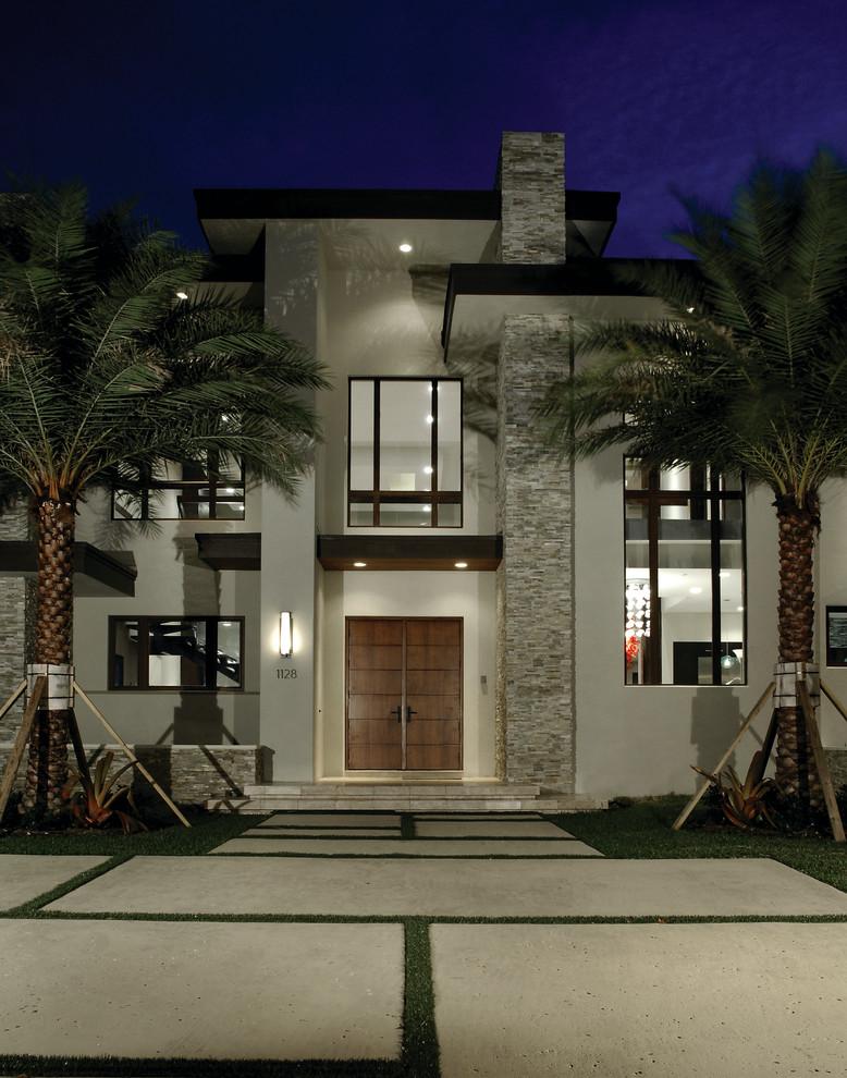 Contemporary white two-story exterior home idea in Miami