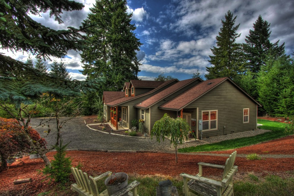 Inspiration for a rustic wood exterior home remodel in Portland