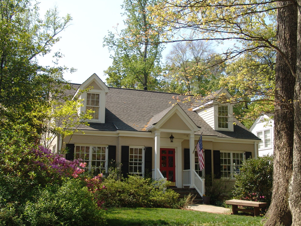 Example of a small classic two-story brick exterior home design in Atlanta