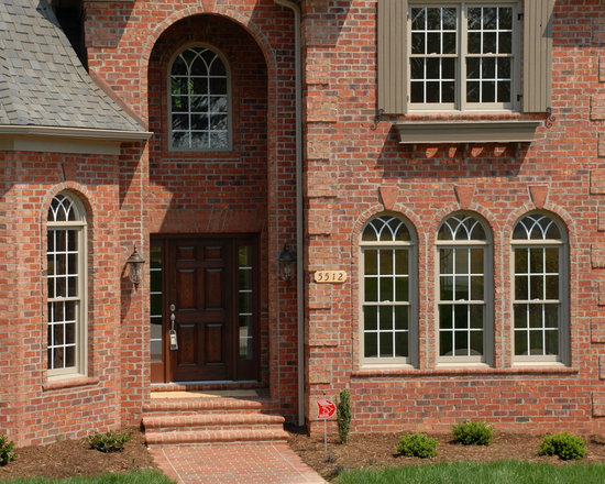 Homes in NC - Rustic Village Oversize Tumbled brick with Stratford Rose Oversize Tumbled accents and Brookstown pavers.