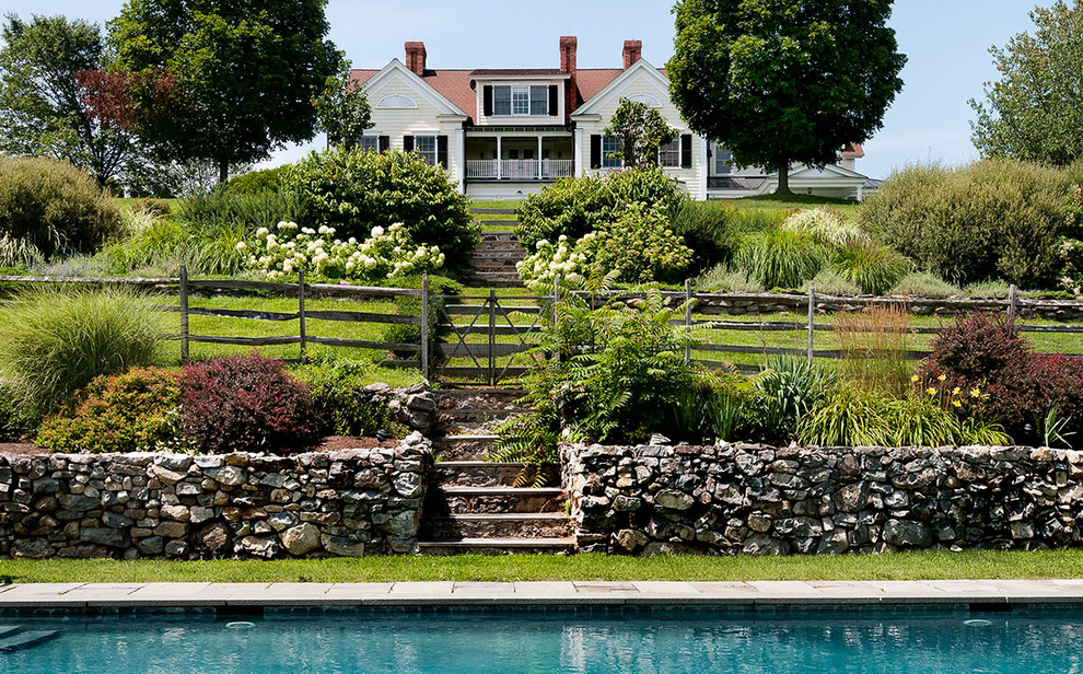 Inspiration for a country exterior home remodel in New York
