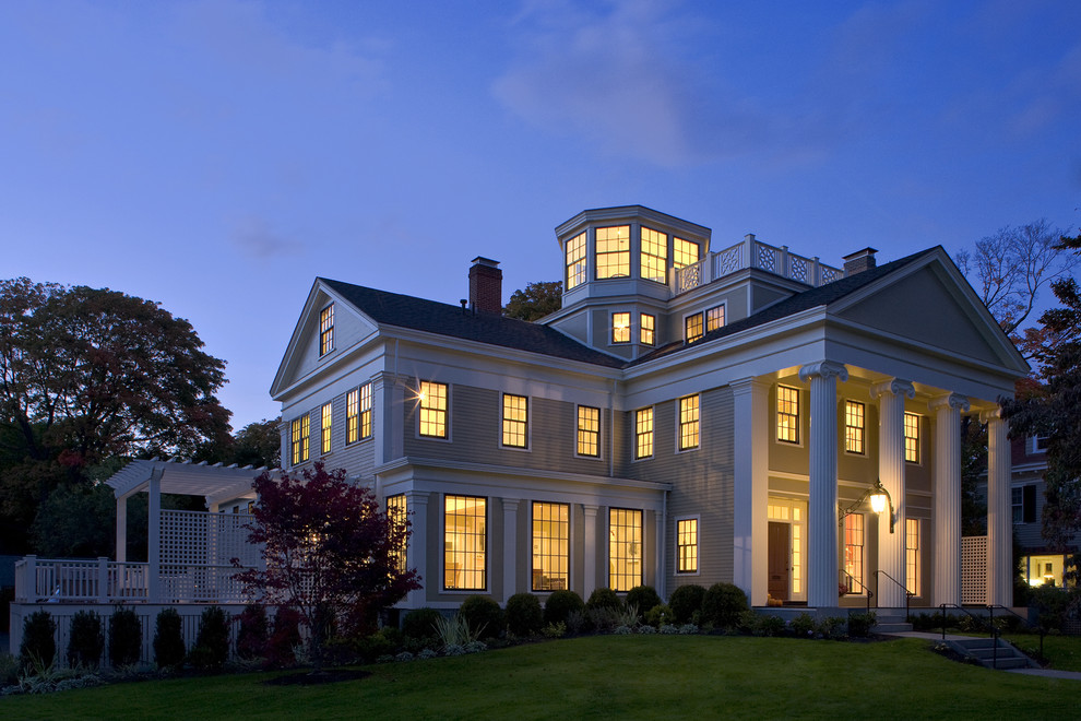 Large traditional three-story wood exterior home idea in Boston