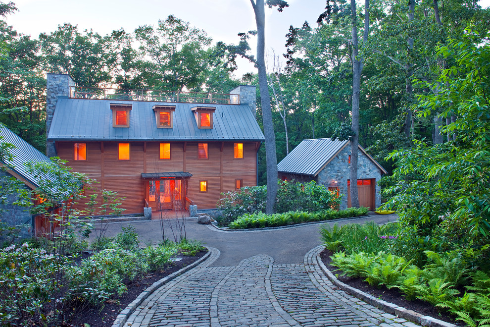 Inspiration for a rustic stone exterior home remodel in DC Metro