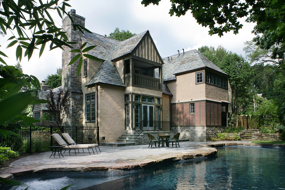 Inspiration for a timeless beige two-story exterior home remodel in New York