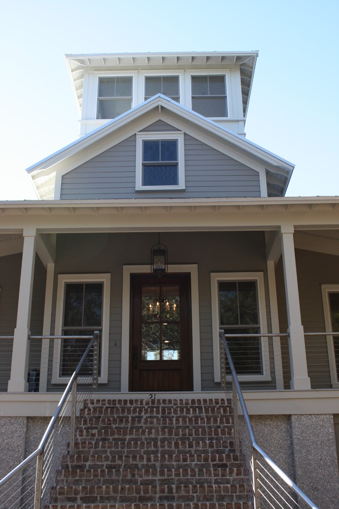 Example of a mid-sized classic gray three-story wood gable roof design in Atlanta