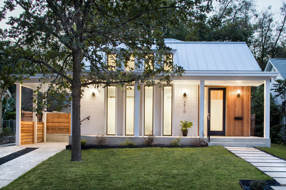 Example of a small trendy white one-story mixed siding exterior home design in Austin with a metal roof