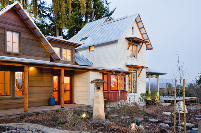 Mid-sized farmhouse wood gable roof idea in San Francisco with a metal roof