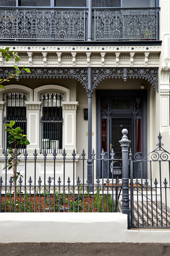 Inspiration for a large victorian two-story brick exterior home remodel in Sydney with a tile roof
