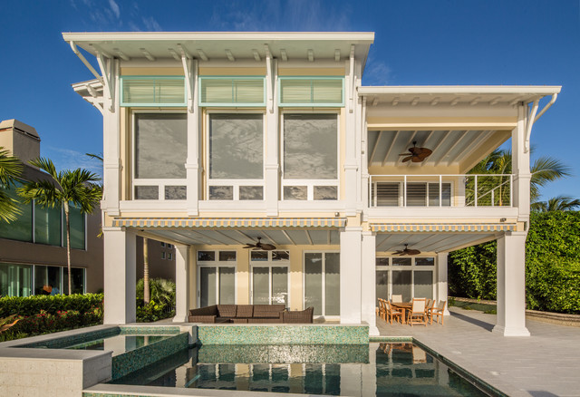 Charming Example Of A Huge Coastal Yellow Two Story Stucco Exterior Home Design In  Miami