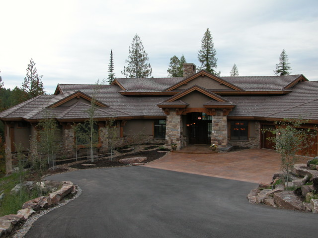 Example of an arts and crafts gray wood exterior home design in Other with a hip roof