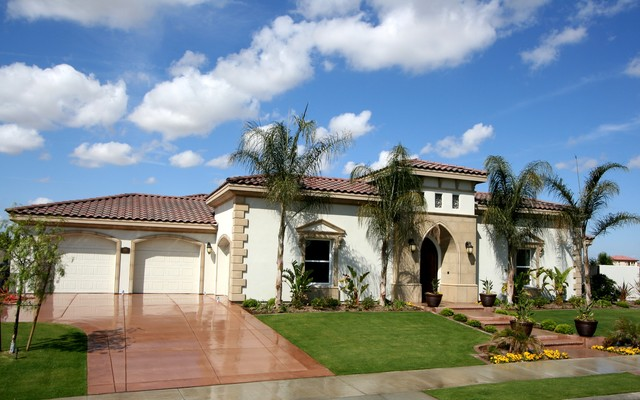 Example of a tuscan exterior home design in Other