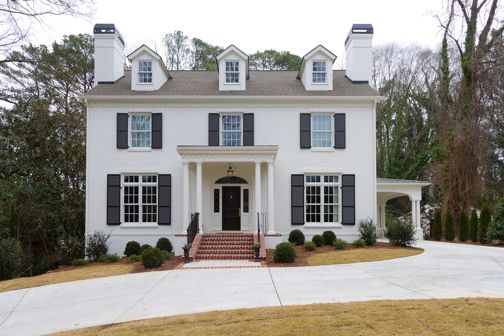 Example of a large classic white two-story brick exterior home design in Atlanta