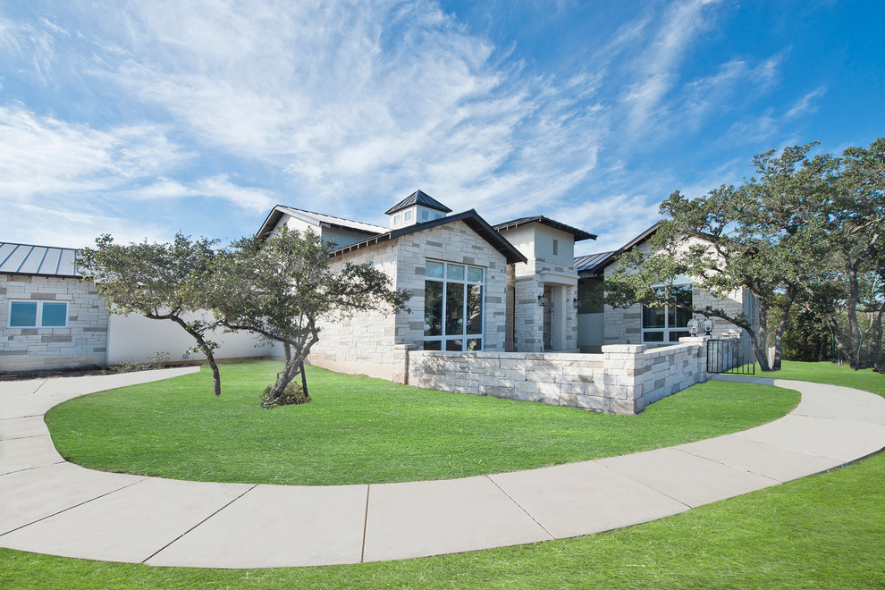 Example of a transitional exterior home design in Austin