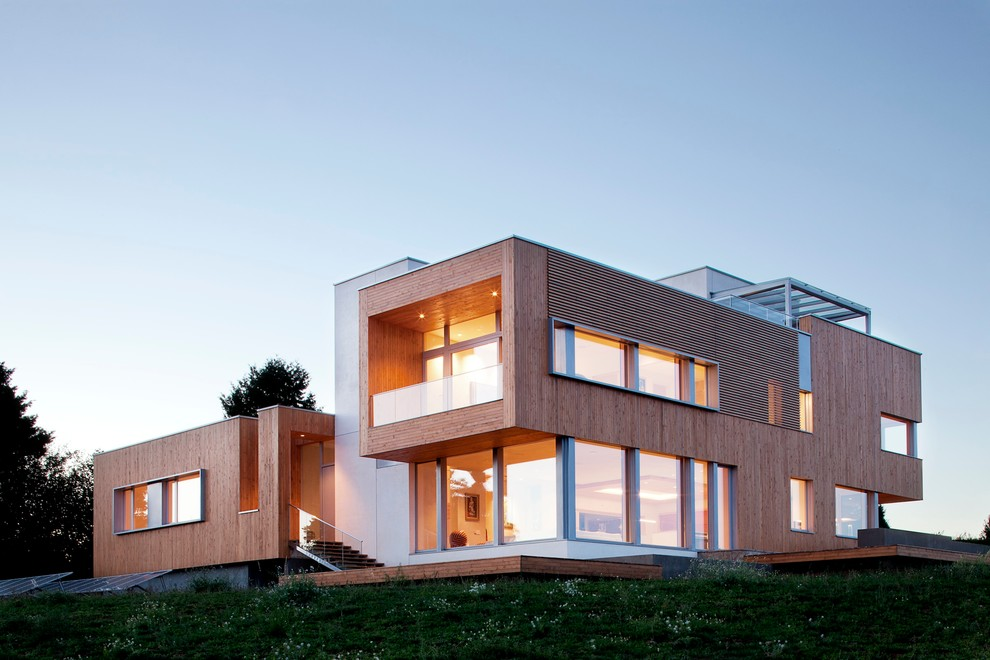 Trendy wood exterior home photo in Portland