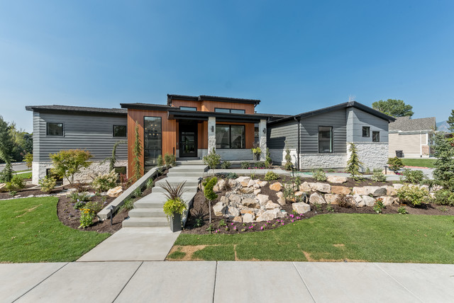 Inspiration for a large contemporary gray one-story mixed siding exterior home remodel in Salt Lake City with a shingle roof