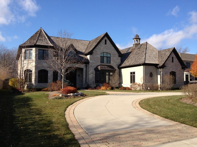 Example of a transitional exterior home design in Denver