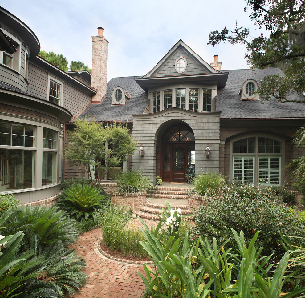 Large traditional gray two-story wood exterior home idea in Charleston with a shingle roof