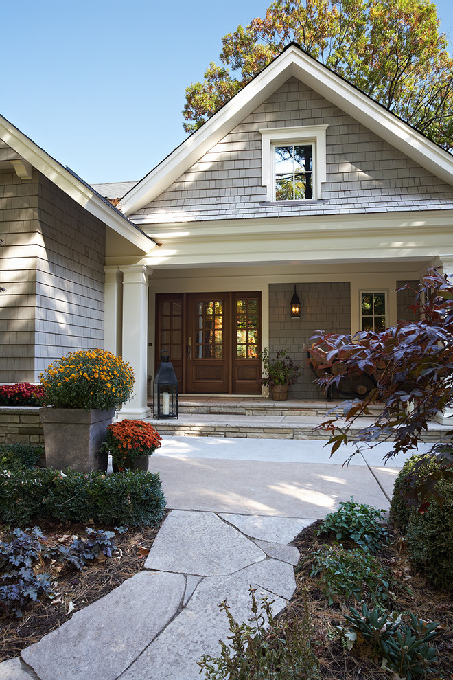Inspiration for a timeless wood exterior home remodel in Minneapolis
