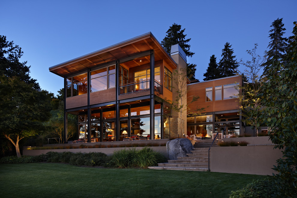 Example of a minimalist wood exterior home design in Seattle