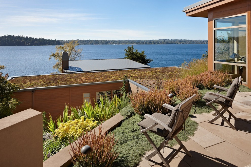Inspiration for a modern wood exterior home remodel in Seattle with a green roof