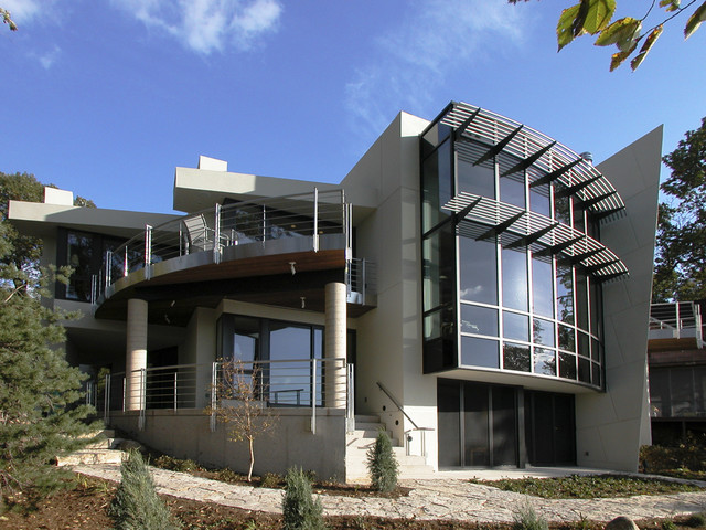 Example of a trendy two-story exterior home design in Other