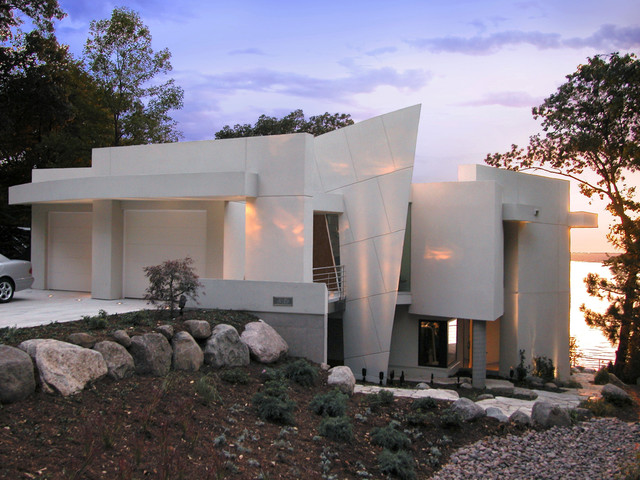 Inspiration for a contemporary two-story exterior home remodel in Other