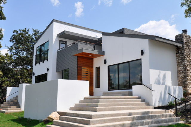 mid sized contemporary white two story stucco exterior home idea in austin with a - Contemporary Color Scheme