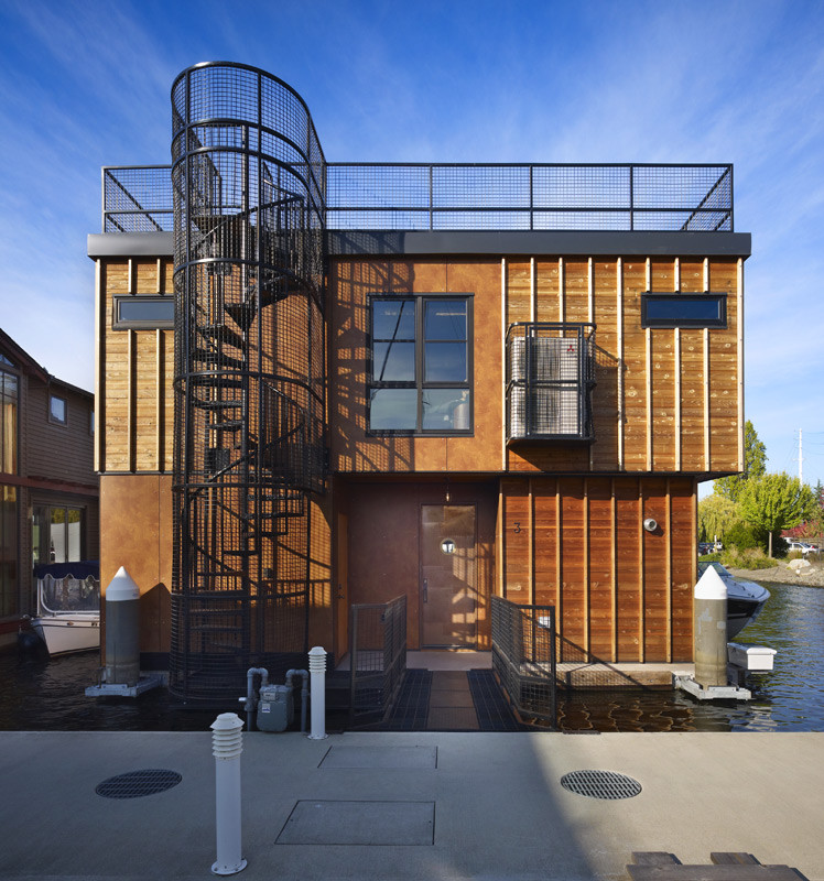 Small urban brown two-story mixed siding exterior home photo in Seattle with a green roof